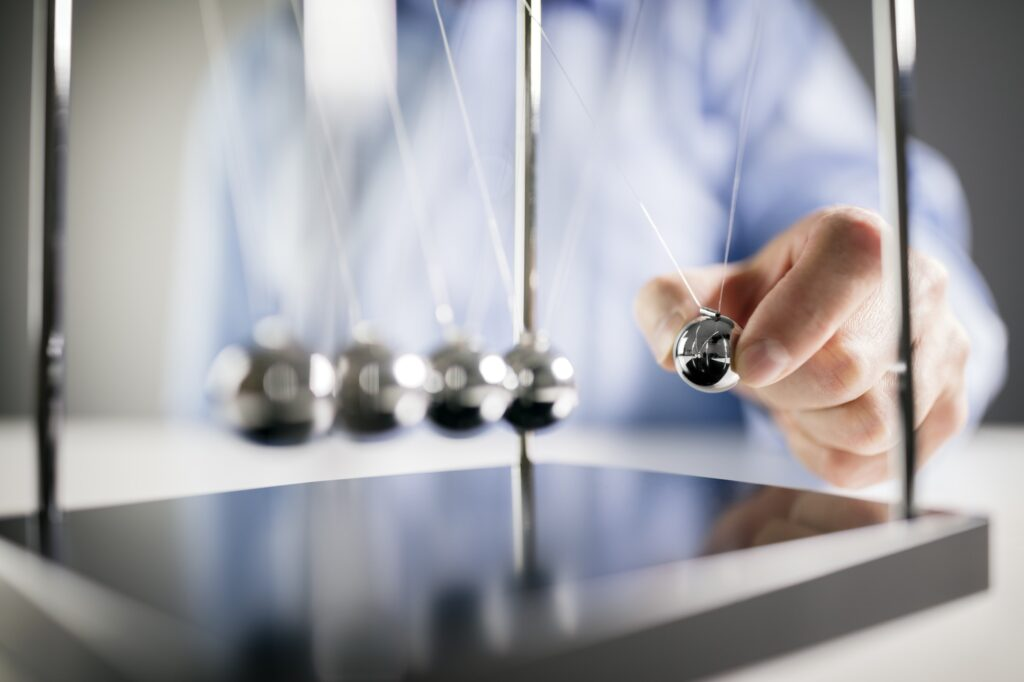 Newton's cradle businessman concept for cause and effect